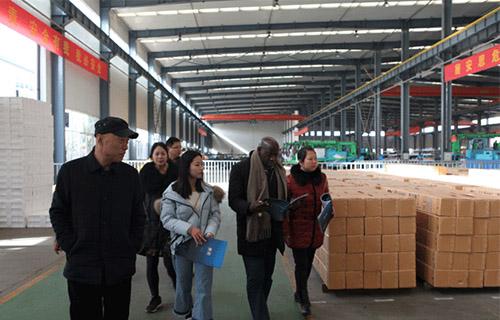 Ugandan customers visit the company